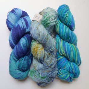 From left to right: Malabrigo Sock in Caribeno, Feza Socktastic Splatter Dash in Sea Spray, and Cascade Heritage Paints in Tropical Seas