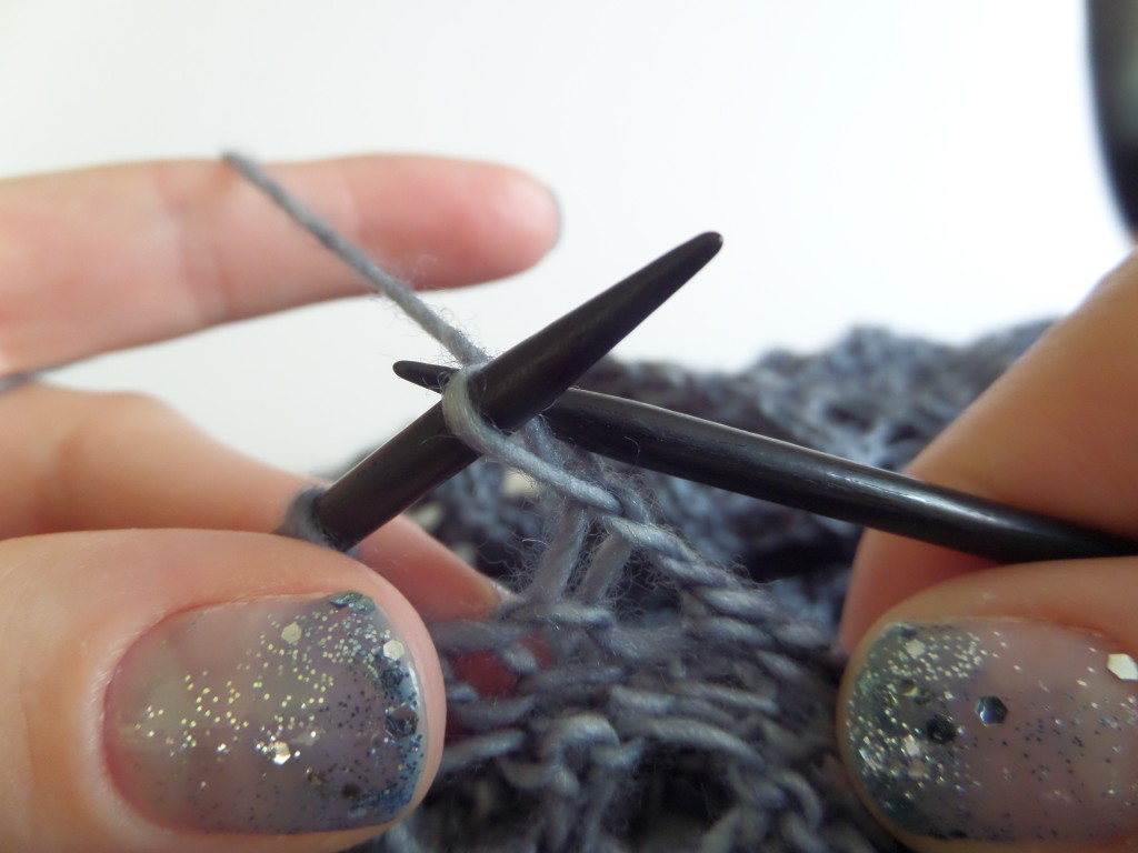 Lift the stitch on the right needle over the yarn over